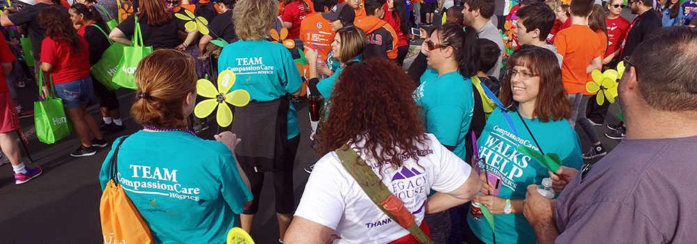 CompassionCare Hospice Team Conversing at Walk To End Alzheimer's